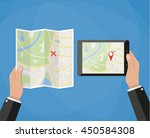 hand holds tablet with city map ... | Shutterstock . vector #450584308