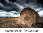 Hay Bale Against Ominous Sky
