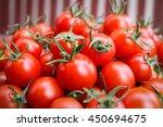 cherry tomato in basket on... | Shutterstock . vector #450694675