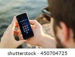 man on the coast entering pin...   Shutterstock . vector #450704725