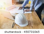 architect drawing on blueprint... | Shutterstock . vector #450731065