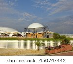 Beach Club, bar, sun loungers and umbrellas on green lawn behind the white fence, Sochi, Russia, June 28, 2016 - stock photo