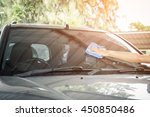cleaning the car glass with... | Shutterstock . vector #450850486