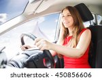young confident woman piloting... | Shutterstock . vector #450856606