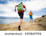 couple runners running with... | Shutterstock . vector #450869596