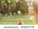 Cute Girl Playing With Blowball