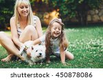 mom with her child relaxing... | Shutterstock . vector #450878086