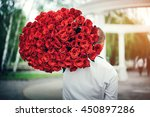 young man with big bouquet of... | Shutterstock . vector #450897286