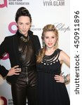Small photo of Hollywood, California; March 2, 2014; Johnny Weir and Tara Lipinski arrive to Elton John AIDS Foundation Presents 22nd Academy Awards Viewing Party.