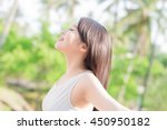 young woman raising her arms... | Shutterstock . vector #450950182