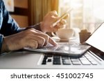 businessman hand using smart... | Shutterstock . vector #451002745