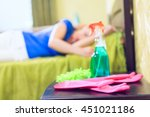 sad girl cleaning furniture in... | Shutterstock . vector #451021186