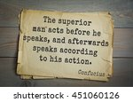 Small photo of Ancient chinese philosopher Confucius quote on old paper background. The superior man acts before he speaks, and afterwards speaks according to his action.