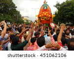 Small photo of HYDERABAD,INDIA-JULY 7:Indian Hindu devotees watch and pray during Jagannath Rath Yatra procession with idols on the chariot on July 7,2016 in Hyderabad,India