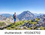 mountaineer enjoying the view... | Shutterstock . vector #451063702