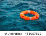 orange lifebuoy in a stormy... | Shutterstock . vector #451067812
