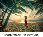 Woman On The Tropical Beach At...