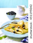thin pancakes with blackberry...   Shutterstock . vector #451195042