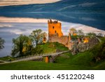 Closeup view of Urquhart Castle. The castle sits beside Loch Ness, near Inverness and Drumnadrochit, in the Highlands of Scotland. Only the tower of the castle is in focus; the rest is blur.