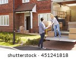 couple unpacking moving in... | Shutterstock . vector #451241818