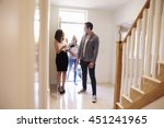 realtor showing young family... | Shutterstock . vector #451241965