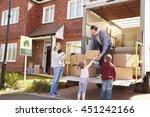 family unpacking moving in... | Shutterstock . vector #451242166
