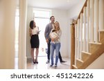 realtor showing young family... | Shutterstock . vector #451242226
