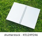 note book on grass. | Shutterstock . vector #451249246