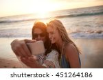 happy young female friends on... | Shutterstock . vector #451264186