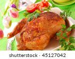baked whole chicken with vegetables for easter dinner - stock photo