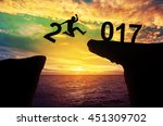 a man hold number 2 jump... | Shutterstock . vector #451309702
