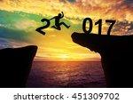 a man hold number 2 jump...   Shutterstock . vector #451309702