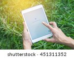 woman hand holding ipad mini 2... | Shutterstock . vector #451311352