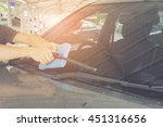 cleaning a windshield wiper... | Shutterstock . vector #451316656