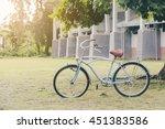 an old bike leaning beside a... | Shutterstock . vector #451383586