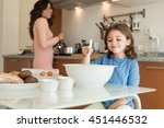mother and daughter cooking in... | Shutterstock . vector #451446532