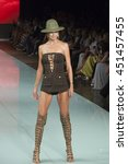 model walks the runway for the... | Shutterstock . vector #451457455