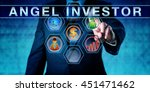 Small photo of Male entrepreneur is pushing ANGEL INVESTOR on an interactive touch screen. Start up finance concept for business angel, informal investor, angel funder or seed investor, especially the tech sector.