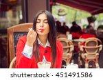 woman in a restaurant enjoying... | Shutterstock . vector #451491586