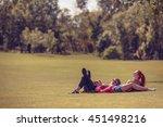 toned. best friends lying on... | Shutterstock . vector #451498216