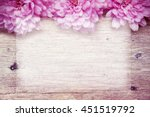 pink flowers on wooden sparkle... | Shutterstock . vector #451519792