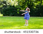 cute little girl playing in... | Shutterstock . vector #451530736