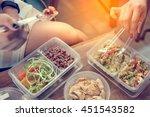 women eating healthy food in...   Shutterstock . vector #451543582