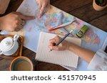 young couple planning honeymoon ... | Shutterstock . vector #451570945