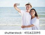 vietnamese smiling young couple ... | Shutterstock . vector #451622095