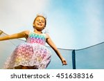 cheerful young girl jumping on... | Shutterstock . vector #451638316