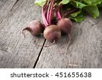 young fresh beets with tops on... | Shutterstock . vector #451655638