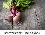 young fresh beets with tops on... | Shutterstock . vector #451655662