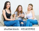 three happy friends talking and ... | Shutterstock . vector #451655902