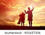 silhouette children on sunset | Shutterstock . vector #451657336